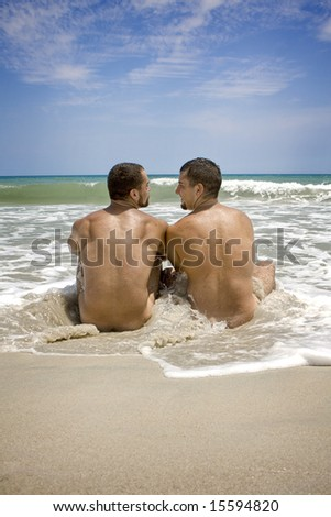 Two gay man sitting at the beach
