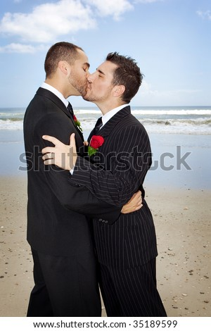 Two gay men getting married on a beach, kissing