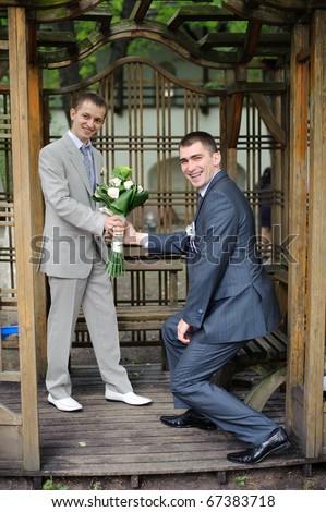two gay men in garden house