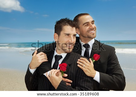 Two gay men married on a beach