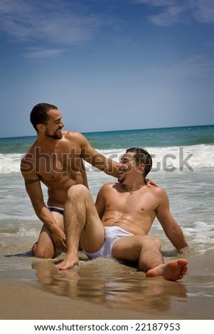 Two gay men vacationing at the beach
