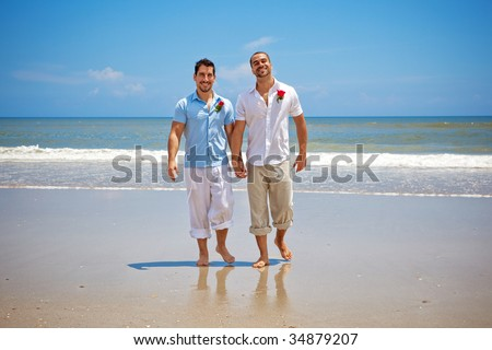 stock photo two gay men walking on a beach after wedding ceremony 34879207 GP 'called gay patients ...