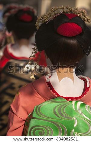 Two Geisha walk the streets of Kyoto, Japan. #634082561