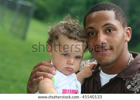 Two Generation Family African American Man with toddler Hot Summer Day