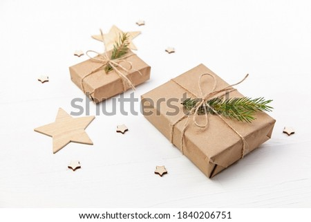 Two gift boxes for New Year and Christmas holidays decorated with fir tree branches, merry christmas conposition.