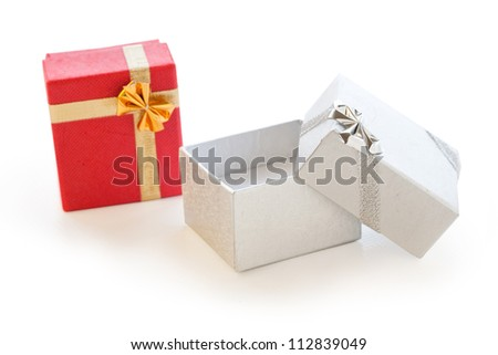Two gift boxes red and silver on white background