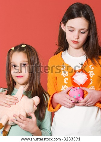 Two girl holding they're toy banks