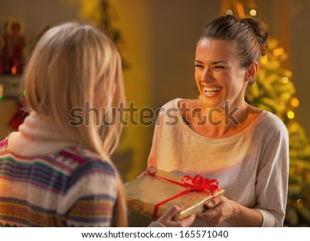 Two girlfriends exchanging christmas presents