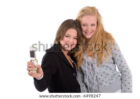 Two girlfriends taking a photo with their mobile phone