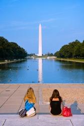 Two girls admiring the Washington monument
