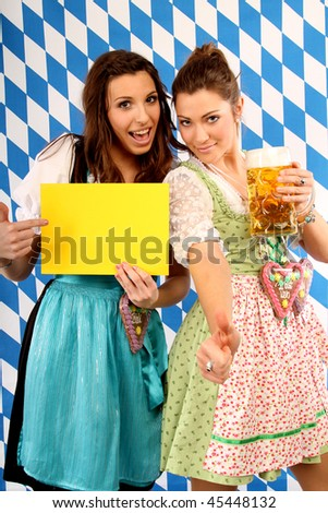 two girls are presenting a yellow card