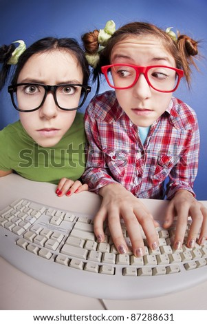 Two girls at the computer, similar available in my portfolio
