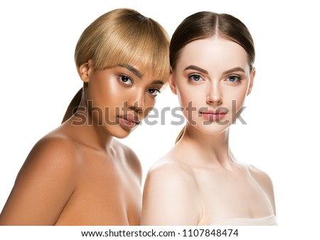 Two girls Different races woman beauty portrait isolated on white african model and caucasian female #1107848474