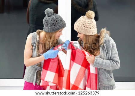 Two girls fighting for blanket