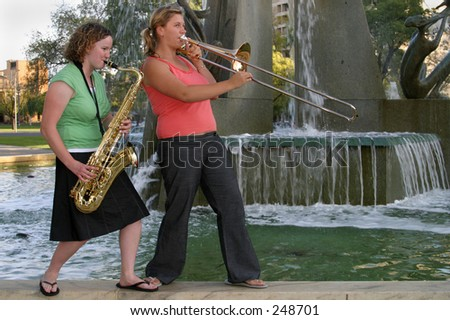 Two girls from the brass section of Final Con, band at the \'Fusion\' Adelaide Christian Easter Festival, Victoria Square, 27th March, 2005