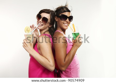 two girls have fun at the party, studio portrait