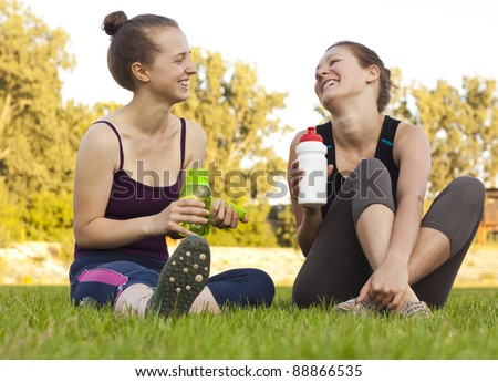 Two girls having a rest, drinking