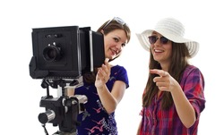 two girls having fun with a proffessional analog photo equipment