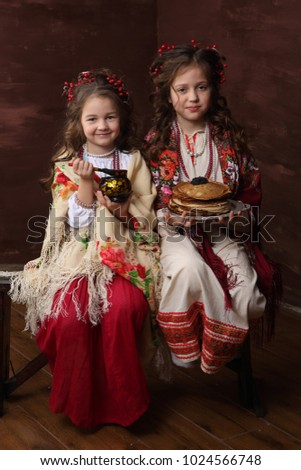 Two Girls In Beautiful Russian Costumes Meet The Carnival Ez Canvas