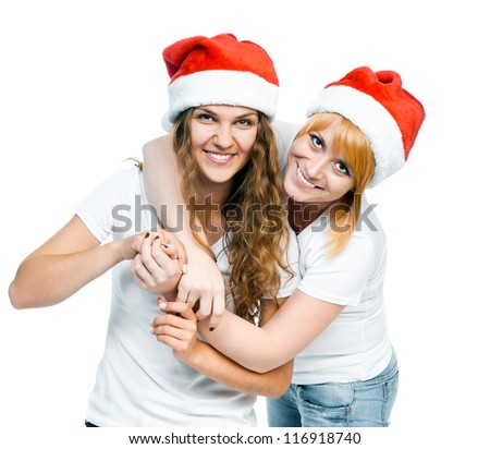 Two girls in Santa hat isolated on white ??
