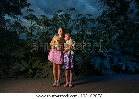two girls in the deep forest at night time