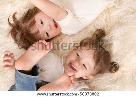 Two girls laughing