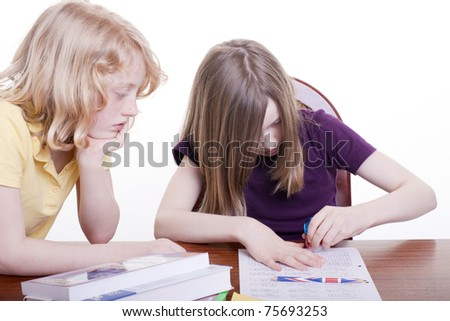 Two girls learn together