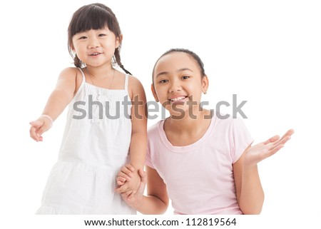 Two girls looking amused or excited about something off the screen