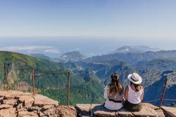 Two girls looking at Vereda da Penha de Águia from Balcões viewpoint in de Faial Area on Pico do Arieiro, Madeira, Portugal.