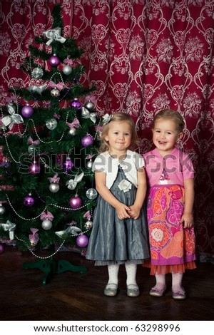 two girls near the christmas tree