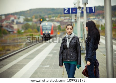 Two girls on railway station