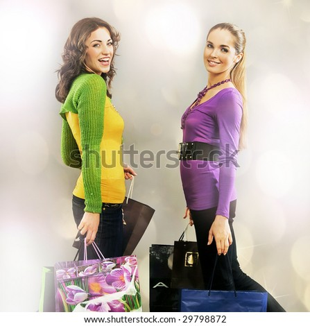 Two girls on shopping trip - stock photo