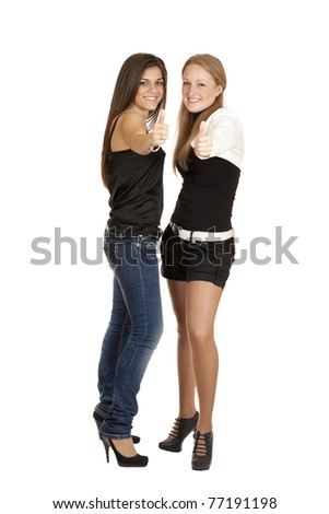 Two girls picked up the thumbs up to his full height isolated on white background - stock photo