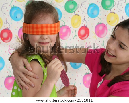 two girls playing game at birthday party