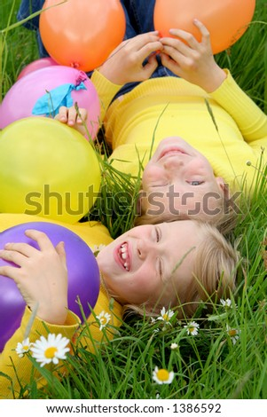Two girls playing with balloons