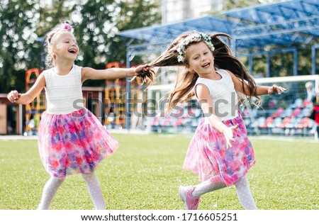 two girls pull hair twins have fun