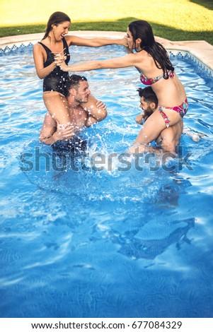 Made Girls wreatling in pool