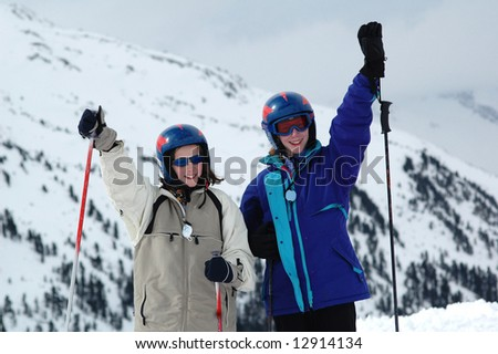 two girls skiing in the Alps