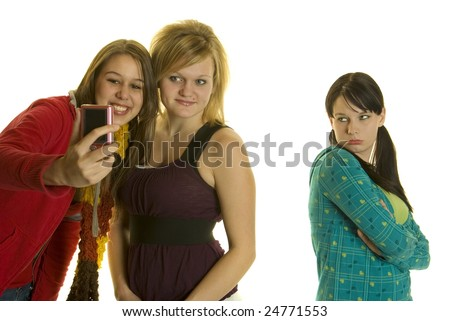 two girls take photo  or video with cell phone camera third girl left out