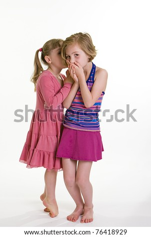 two girls telling secrets - stock photo
