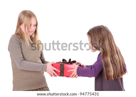 Two girls with a present/sisters/