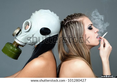 two girls with cigarette and gas mask