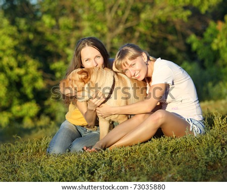 Two girls with dog in summer