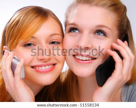 Two girls with mobiles