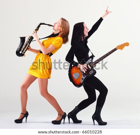 Two girls with musical instruments.