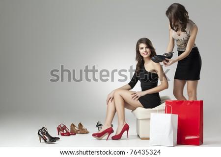 two glamorous women shopping high heels