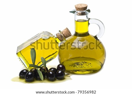 Two glass bottles of virgin olive oil and some black olives isolated on a white background. - stock photo