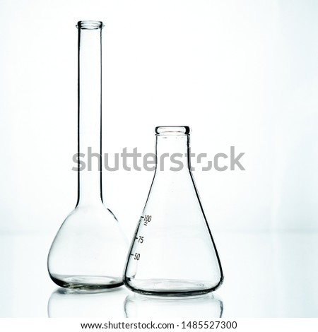 Two glass flasks. Chemical flask. Chemical vessels.