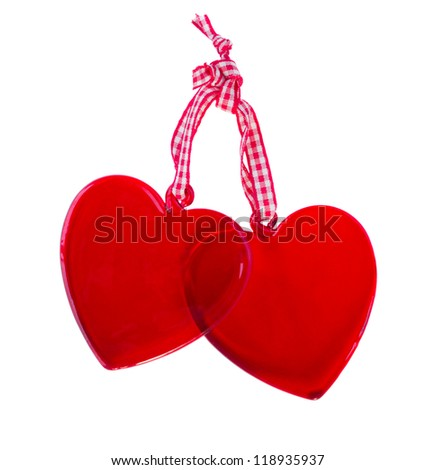 two glass hearts isolated on white background