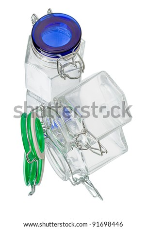Two glass jars on a mirrored table. Isolated on a white background